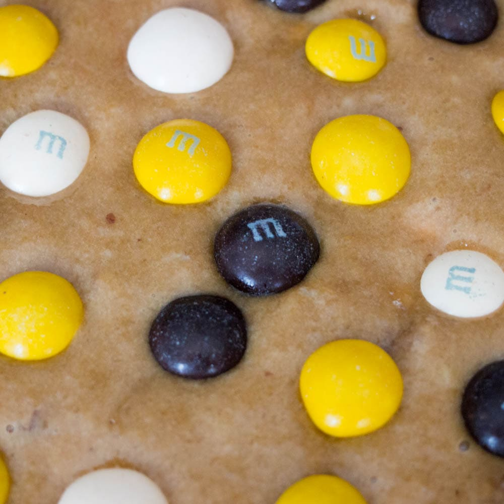 Putting M&M's® on top of the Pecan Cookie Pie