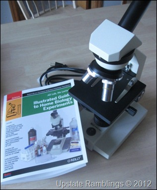 microscope and biology book