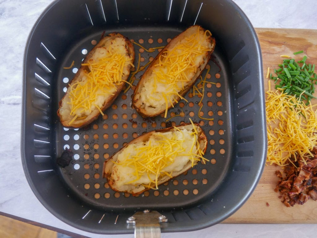 cooking twice baked potatoes in an air fryer basket