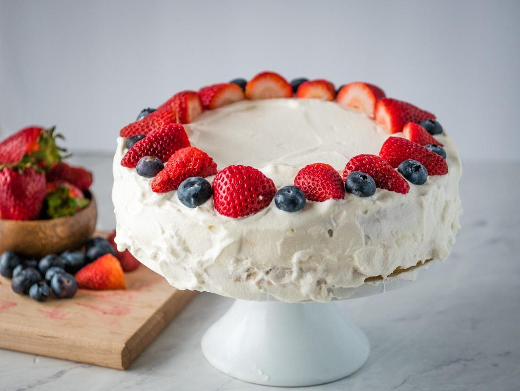 Norwegian blotkake on a cake stand
