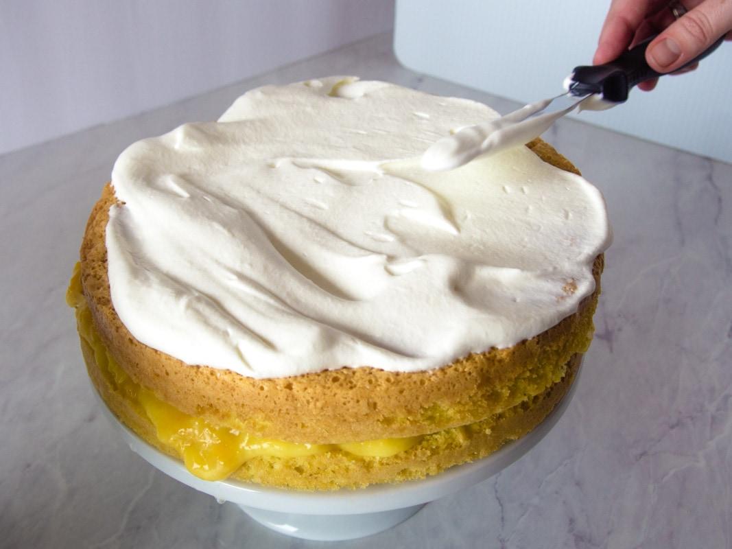 frosting the blotkake with whipped cream - norwegian cream cake