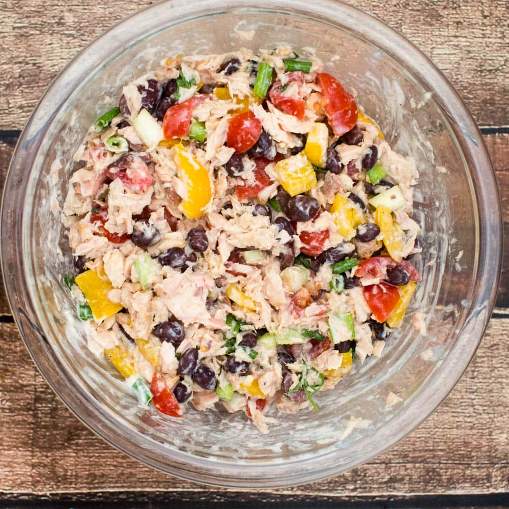 Southwestern Tuna Salad - an easy and healthy lunch idea featuring tuna fish with black beans, tomatoes and cilantro, with a Greek yogurt dressing.