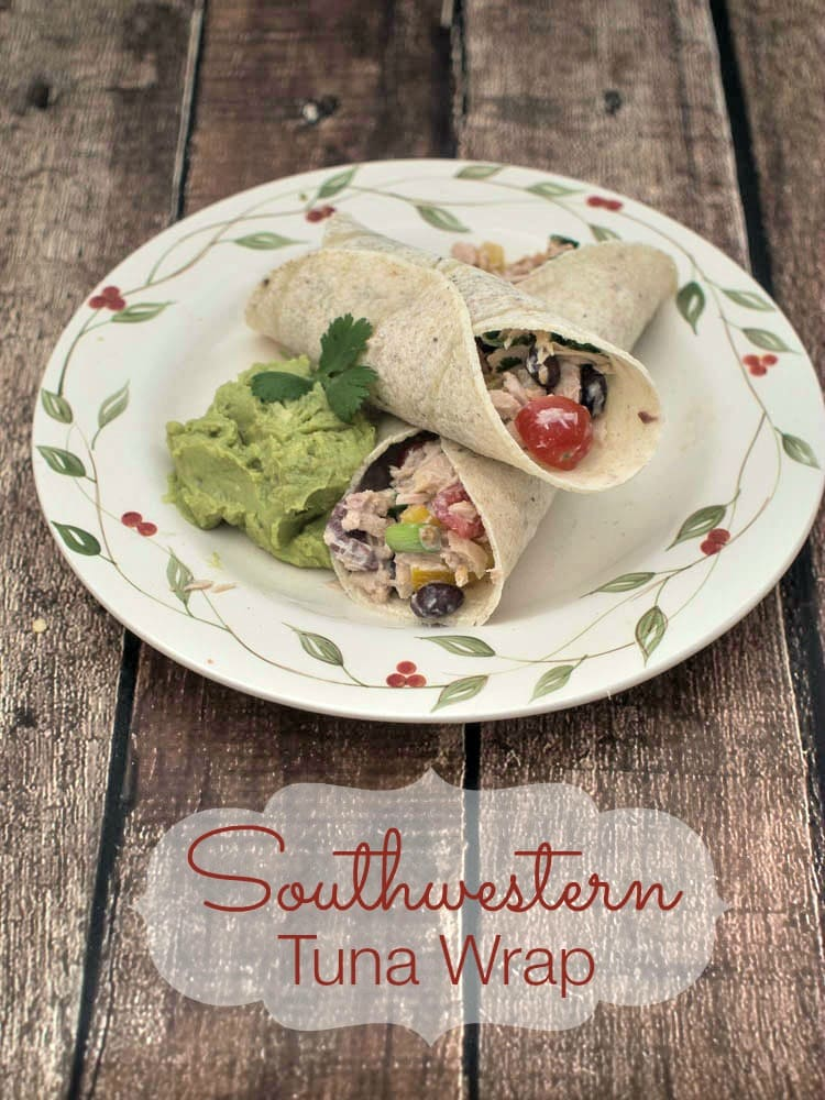 Southwestern Tuna Wrap - an easy and healthy lunch idea featuring tuna fish with black beans, tomatoes and cilantro, with a Greek yogurt dressing, wrapped in corn tortillas.