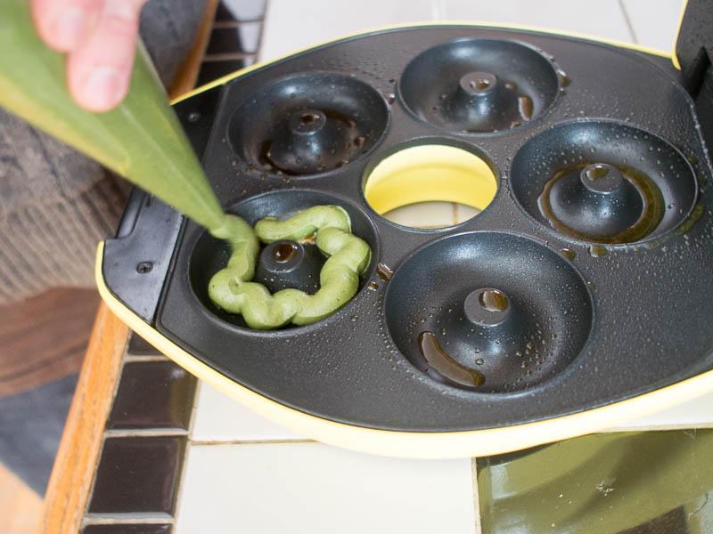 Baking green donuts in a mini donut maker