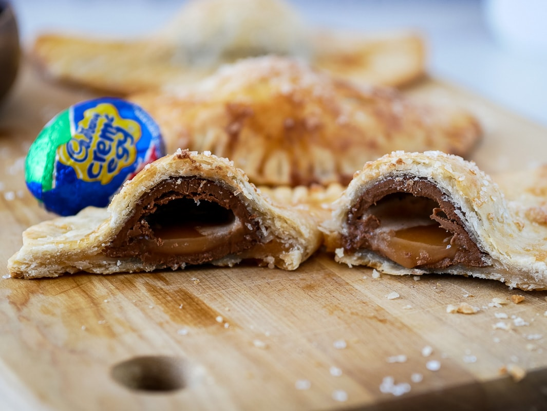 Cadbury Creme Egg pies cut in half to show the filling