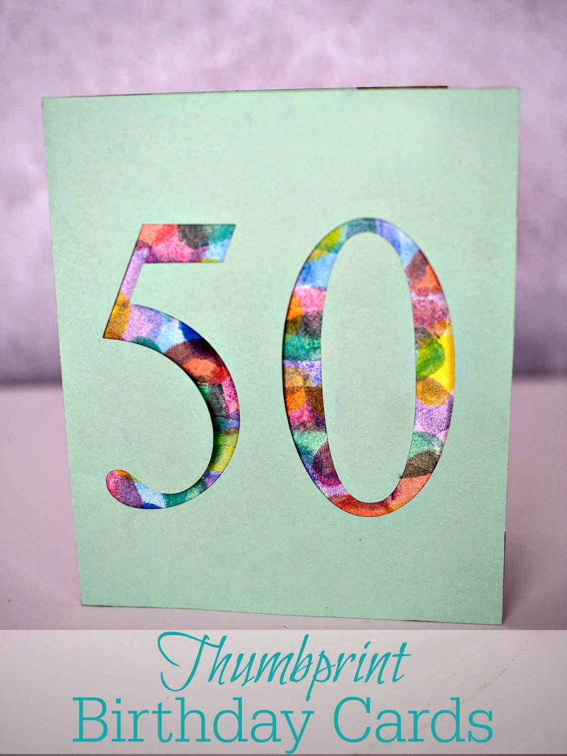 Thumbprint Birthday Cards - These cute cards are made by cutting out numbers and decorating the cut outs with thumbprints.  A cute way to personalize a card!