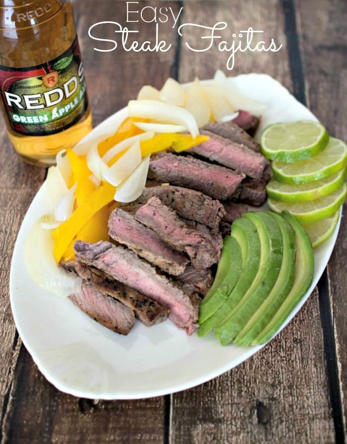 Easy Steak Fajitas - steak marinaded in Redd's Apple Ale, served with onions, peppers, avocado and lime