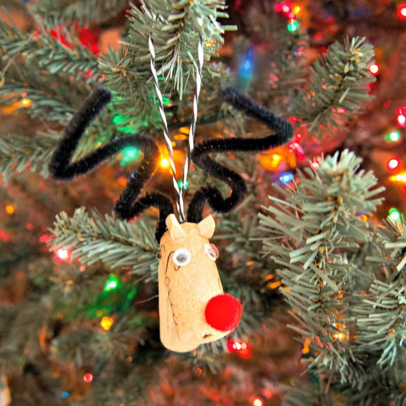 Wine Cork Reindeer Christmas Ornament - an easy craft make with wine corks, wiggly eyes, pom poms, and pipe cleaners