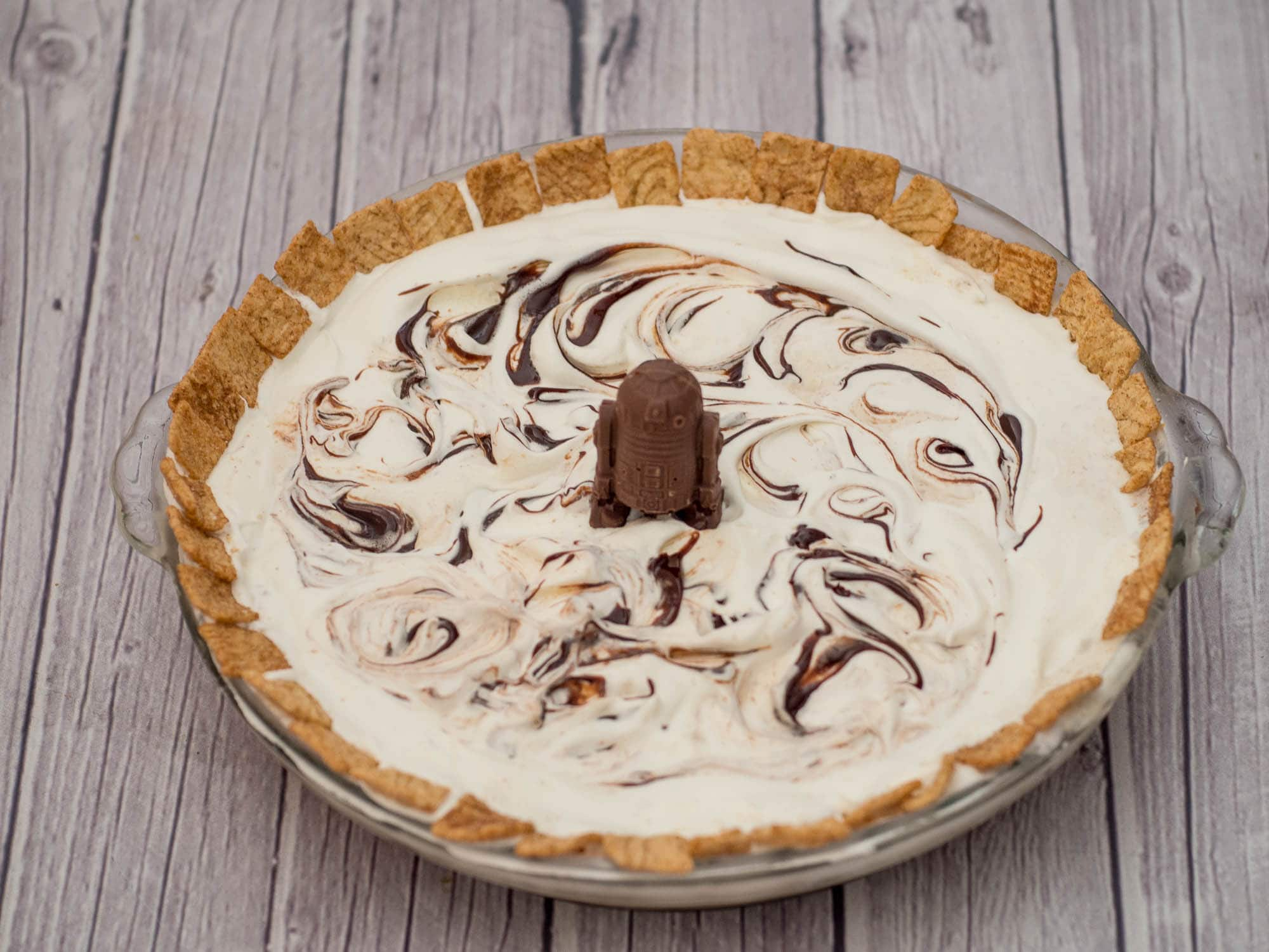 Cinnamon Ice Cream Pie - this easy to make dessert is Star Wars themed and made with Cinnamon Toast Crunch Cereal, Ice Cream, Whipped Topping and Hot Fudge. An easy family dessert!