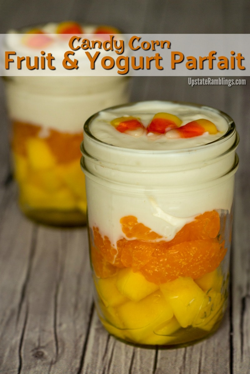 Candy Corn Fruit and Yogurt Parfait - an easy Halloween treat that is healthy too! Layers of mango and oranges are topped off with Greek yogurt for a Halloween Snack that mimics the colors of candy corn. #halloween #halloweensnack #yogurtparfait