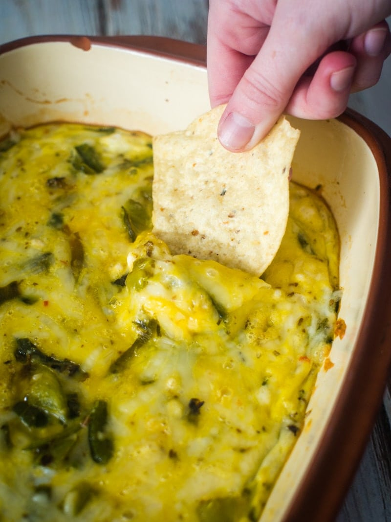 Chile Rellenos Casserole - This easy casserole is made with fresh chile peppers and is perfect for dipping tortilla chips and eating while watching football. This authentic Mexican casserole is made with fresh Poblano, Anaheim, California and Jalapeno peppers. #chilerellenos #casserole #mexicanfood