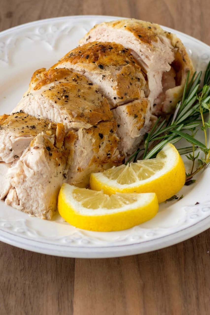 This Sous-Vide Chicken Breast with lemon and herbs is juicy and tender - Sous-Vide cooking gives you perfect chicken every time. Learn how easy sous-vide cooking is and get the recipe now! #ad #SousVidePerfection #sousvide #chickendinner #chicken