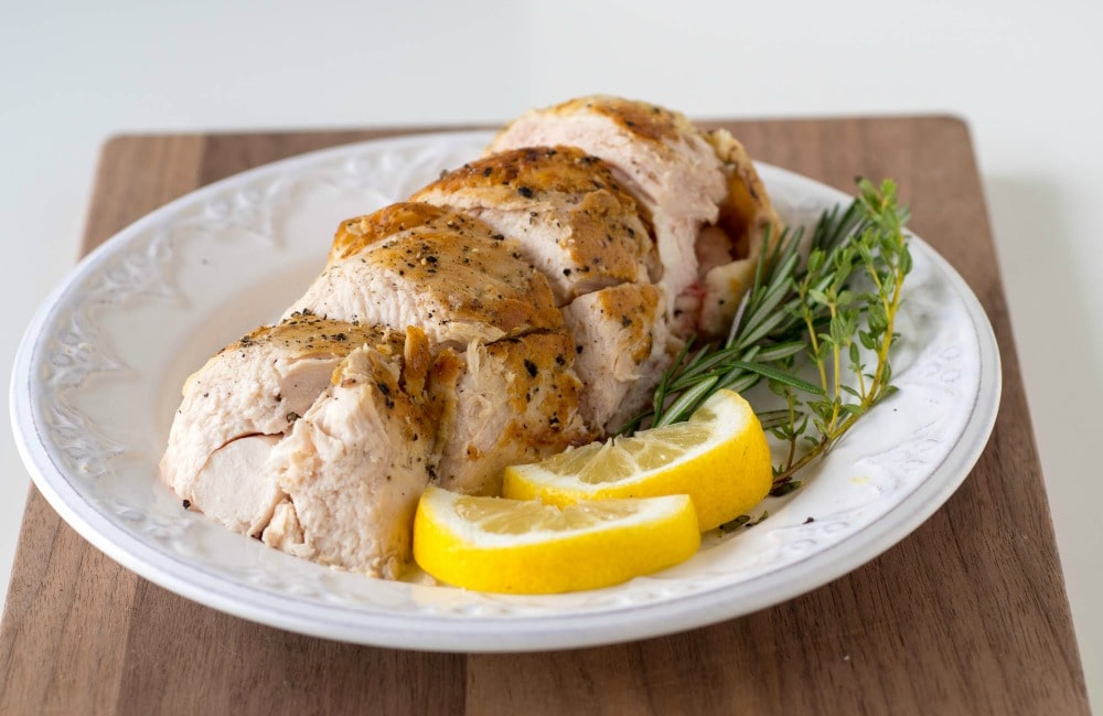 Sous-Vide Chicken Breast with Lemon and Herbs ready for eating