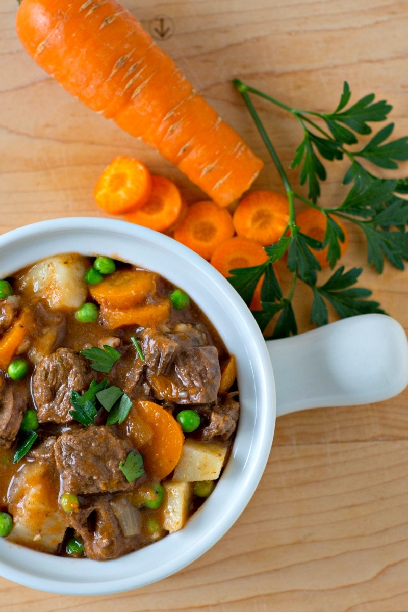This recipe for Instant Pot Beef Stew uses apple cider to create a tasty and slightly sweet gravy for the tender chunks of beef and hearty vegetables. The apple cider adds a nice fall twist to traditional homemade beef stew. And since it is made in a pressure cooker it is ready to go in less than an hour! #instantpot #beefstew #applecider #pressurecooker