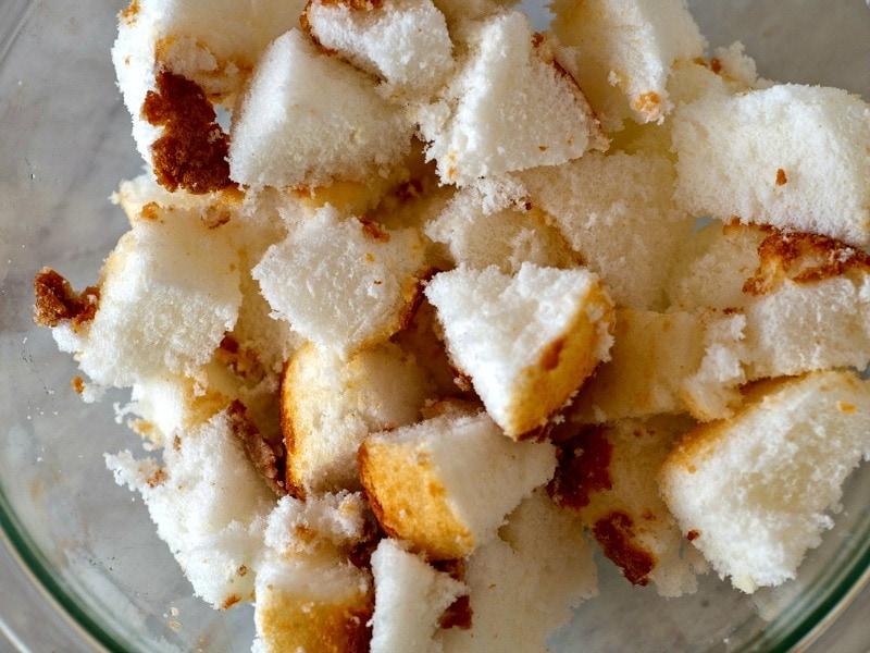 Bowl of cubed angel food cake for easy tiramisu cheesecake trifle