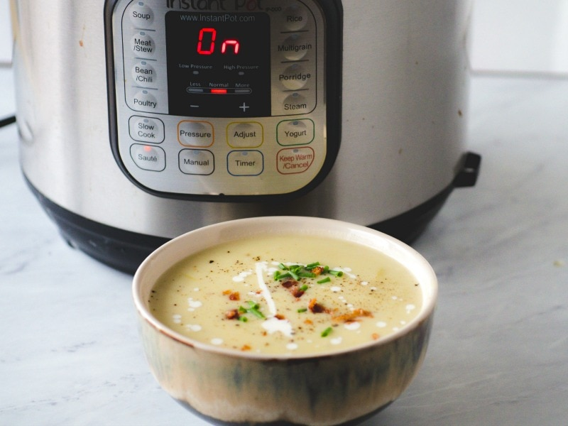 instant pot potatoes soup - soup in front of Instant Pot pressure cooker