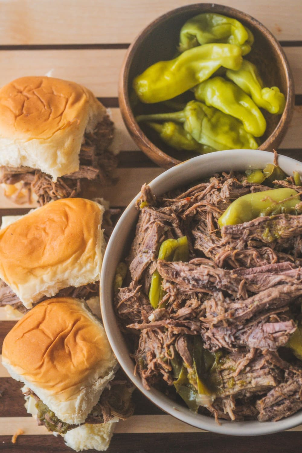 This Instant Pot Italian Beef Sandwich is a perfect for a family dinner or serving for a party! Juicy beef is cooked with Italian pepperoncini and shredded for a spicy beef sandwich filling. Great for a family dinner or on slider for a game day party! #instantpot #Italianbeef