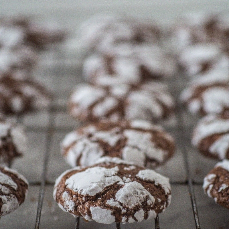 cooling rack full of chocolate crinkle cookies
