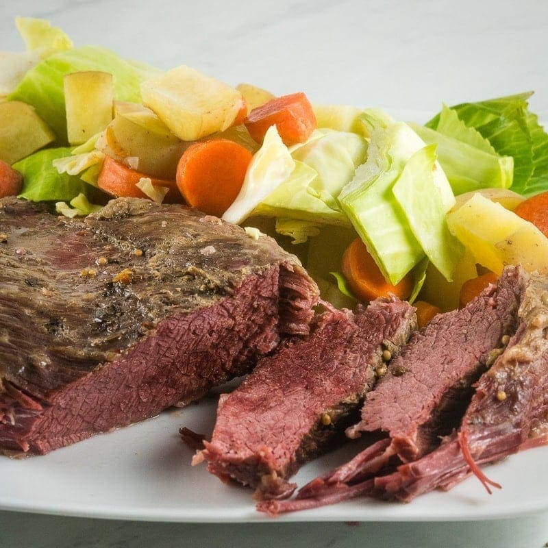 Plate of Instant Pot Corned Beef and cabbage with carrots and potatoes