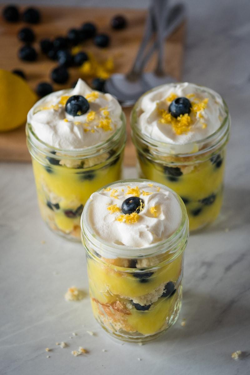three mason jars with blueberry lemon trifle