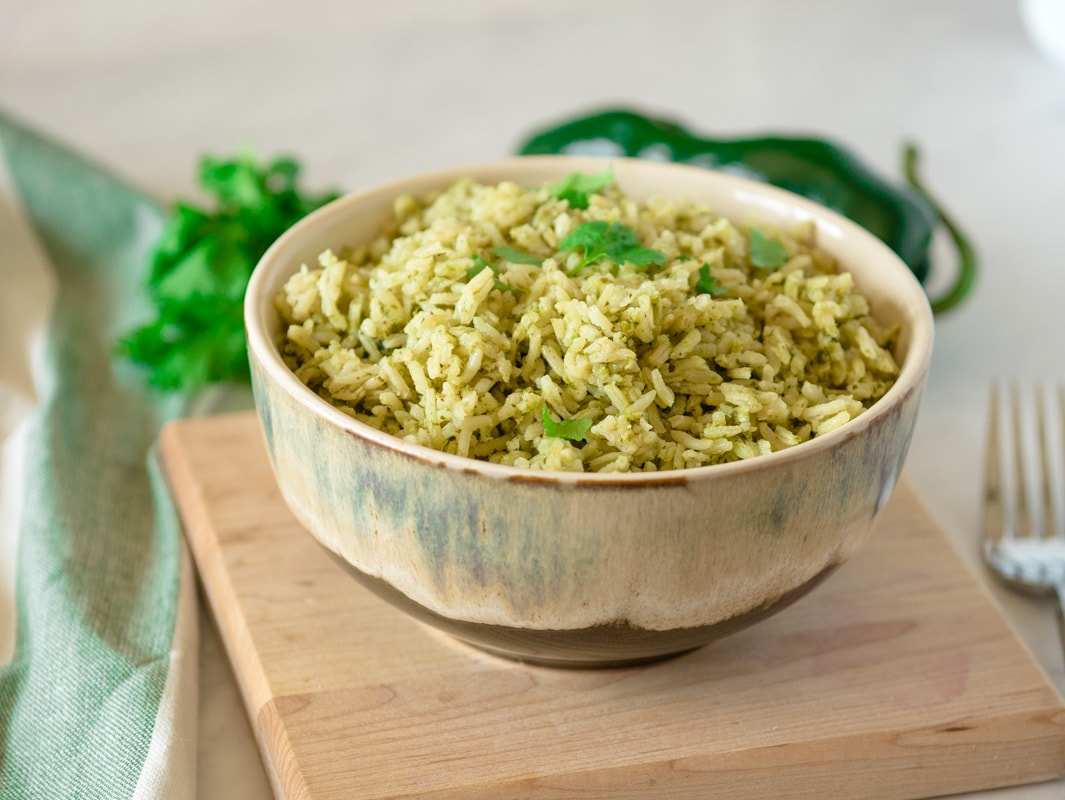 bowl of Mexican green rice made the a pressure cooker
