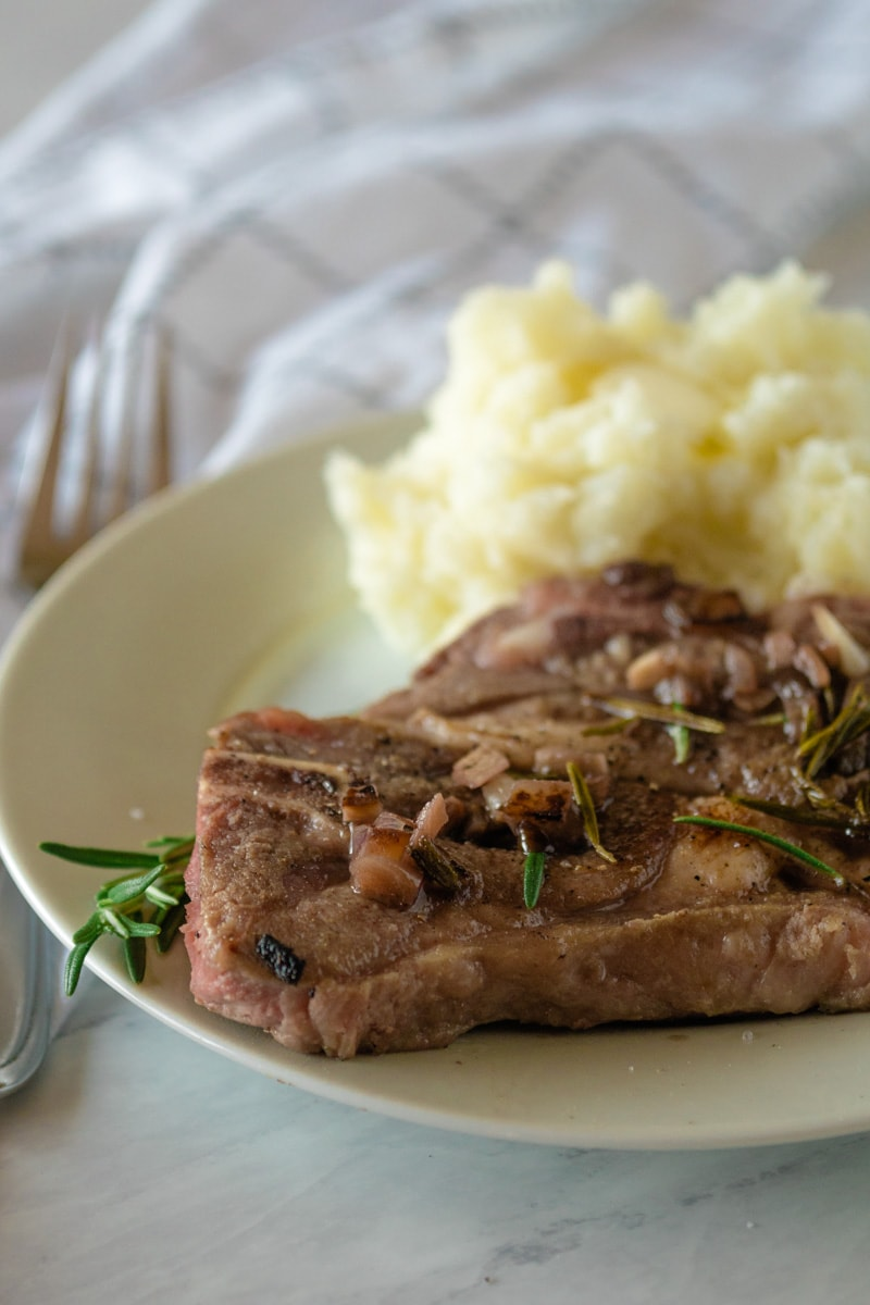 Plate with lamb chop - sous vide - along with mashed potatoes and rosemary