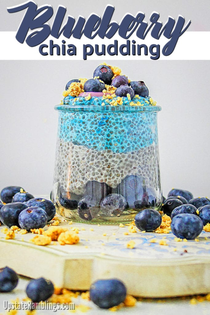 Glass jar of layered blueberry chia seed pudding