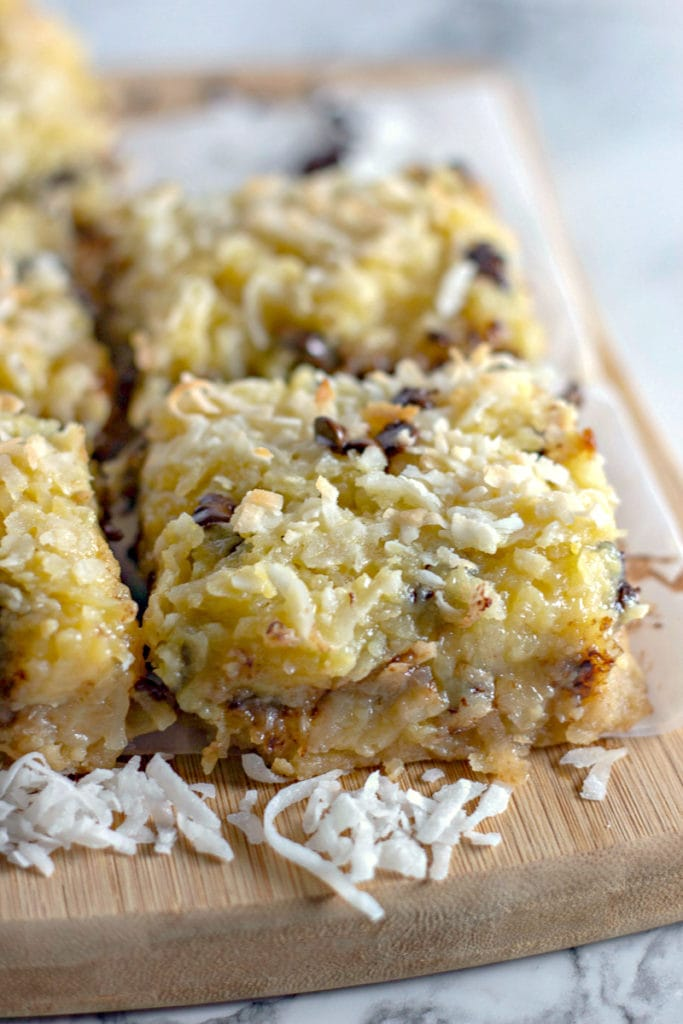 coconut bars on a wooden cutting board