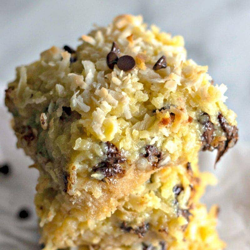 close up of coconut bars with chocolate chips