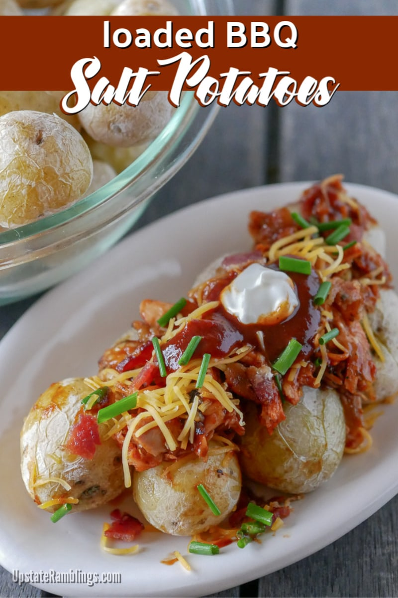 These BBQ loaded salt potatoes take the Central New York tradition of salt potatoes to a new level. These tiny salt crusted potatoes are topped with BBQ chicken, Hunt's Hickory Pepper BBQ Sauce, cheese, bacon, sour cream and chives for a smoky, creamy and cheesy comfort food. #ad #GrillingGetTogether #BBQ #potatoes