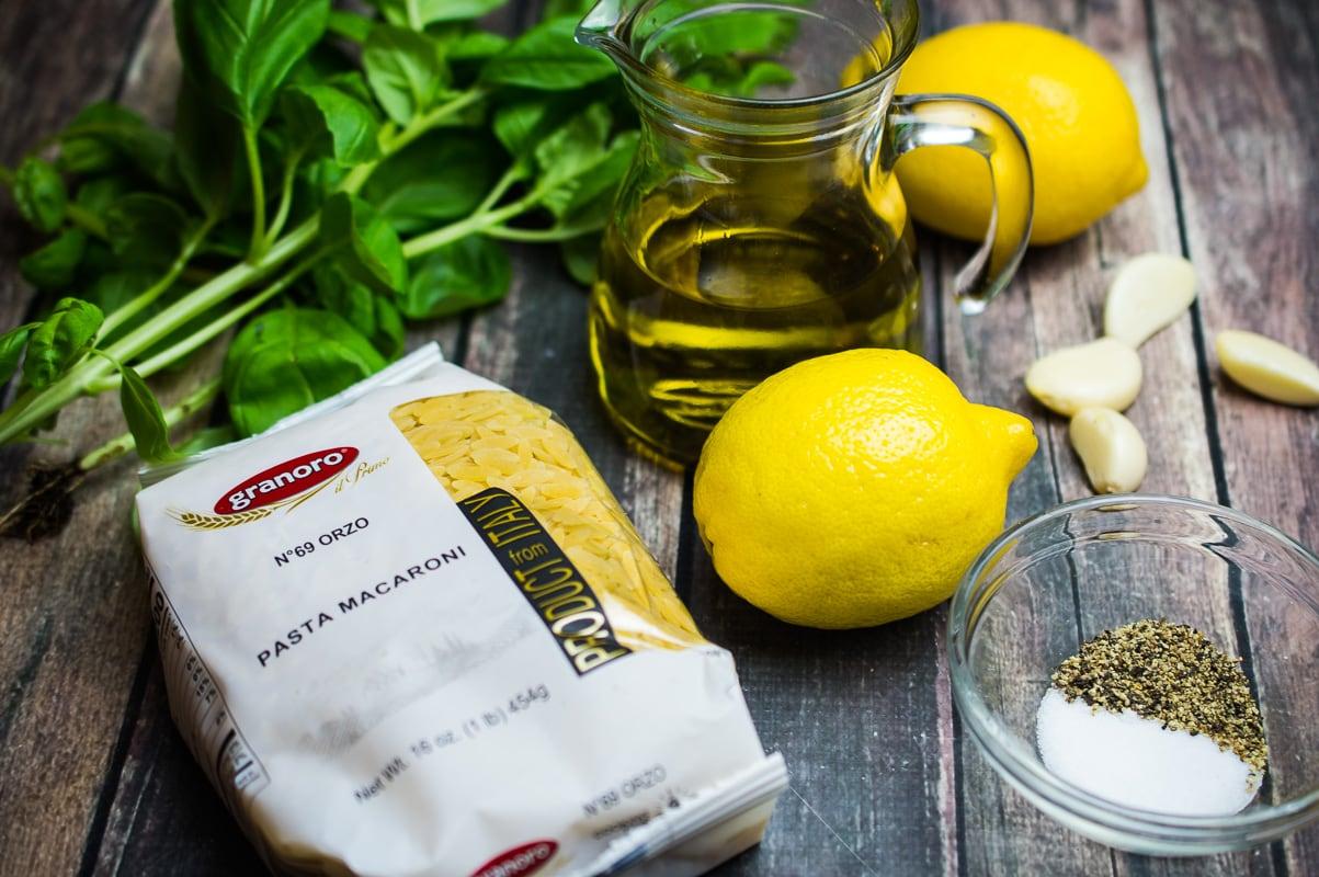 ingredients for orzo pasta salad - basil, lemon, olive oil, orzo, garlic