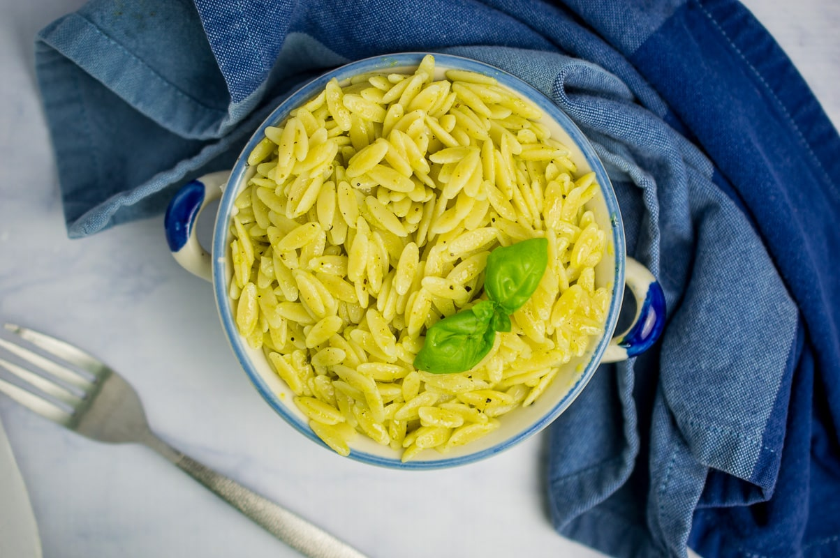 Orzo pasta salad from top with blue towel