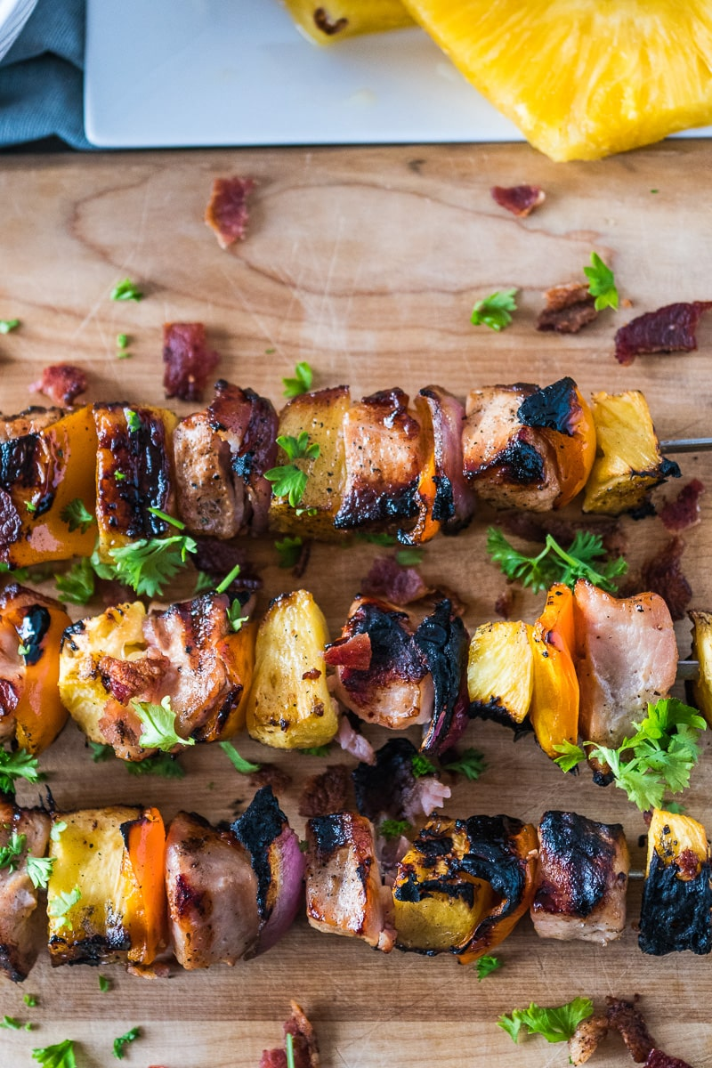 These grilled pork kabobs are a quick recipe made with marinaded pork loin filet, bacon, pineapple, onions and peppers. These pork skewers are an easy, family friendly, dinner with only 5 ingredients that you can have on the table in about 30 minutes!#ad @SmithfieldBrand @Walmart #SmithfieldFlavors, #RealFlavorRealFast #pork #kabobs #grilling