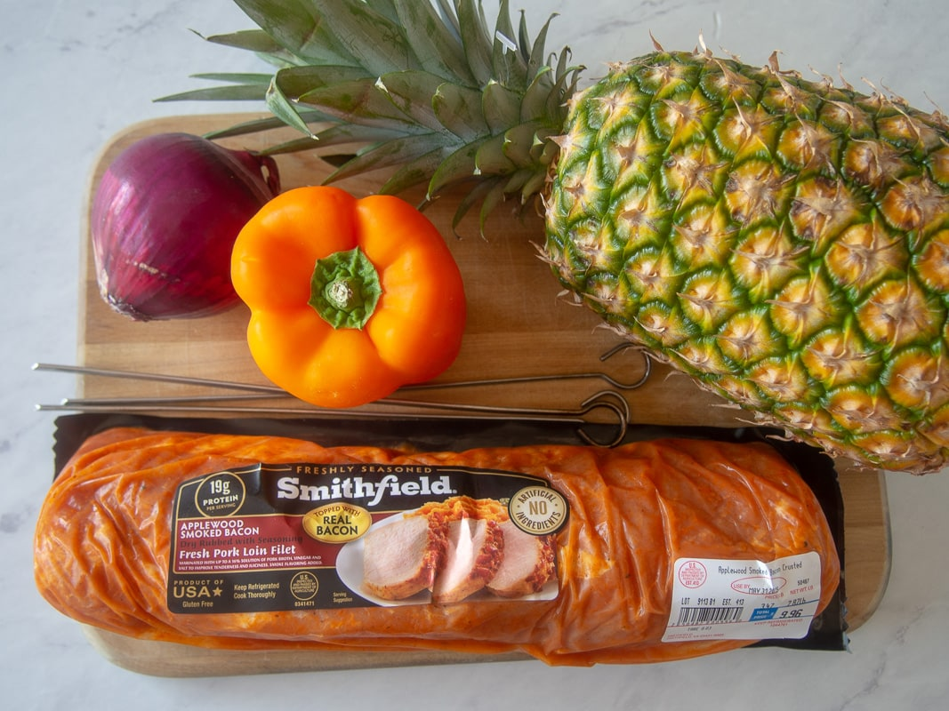 Ingredients for making pork kebobs - pork, pineapple, orange pepper, onion