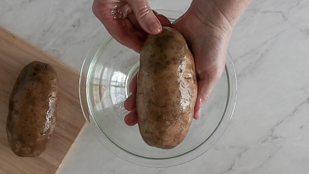 oiling the outside of the baked potatoes