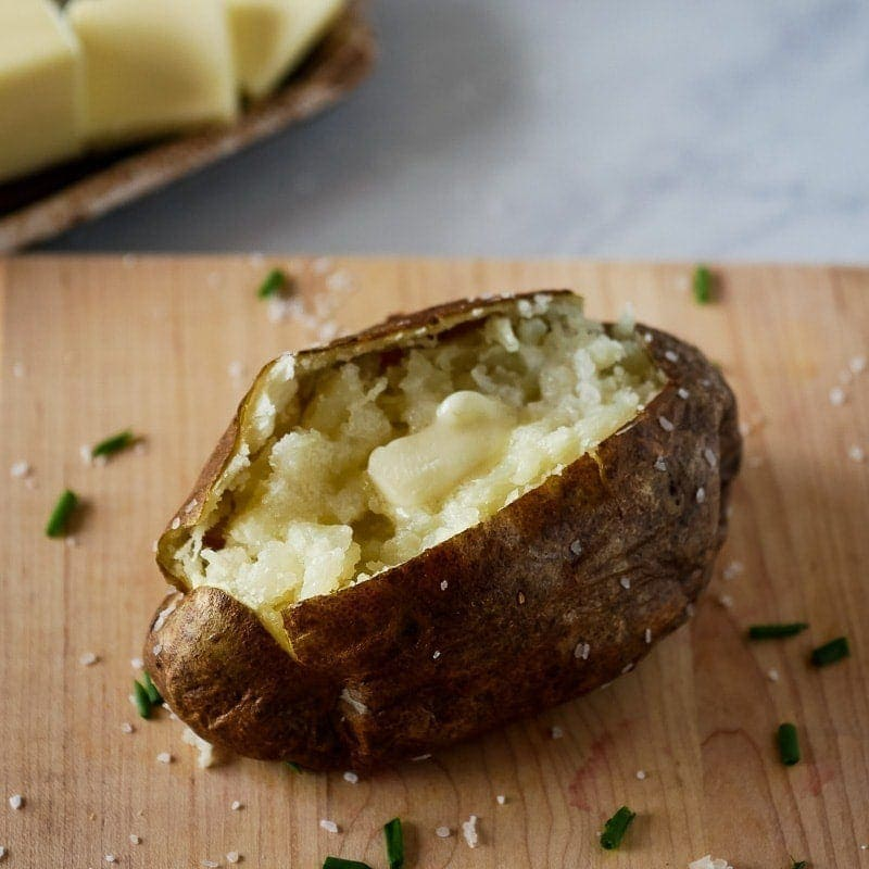 Air fryer baked potato on a cutting board