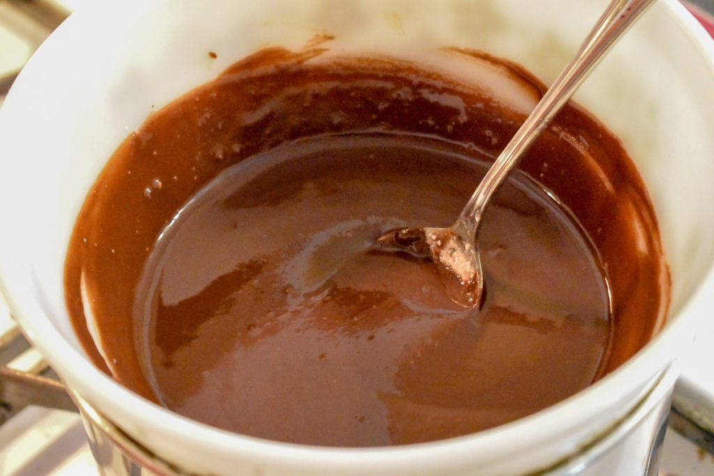 making chocolate glaze for donuts