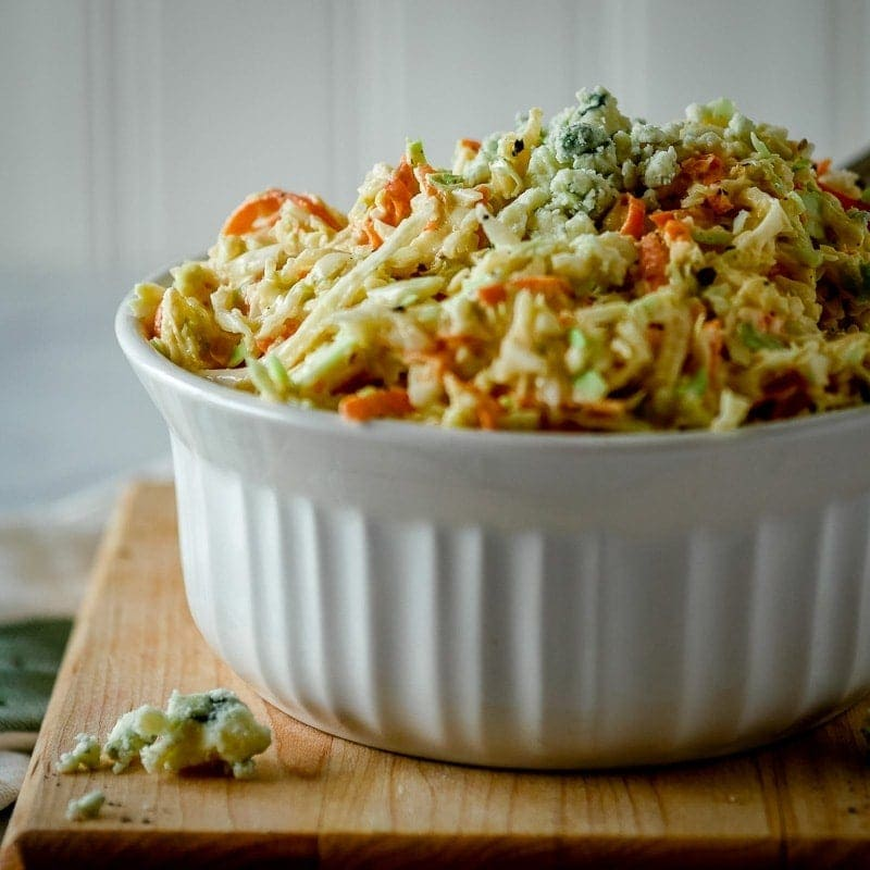 side view of bowl of blue cheese coleslaw
