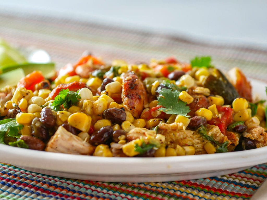 closeup look at grilled chicken salad with corn and black beans