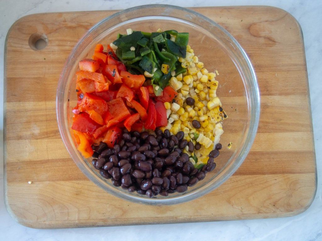 grilled chicken salad ingredients in a bowl