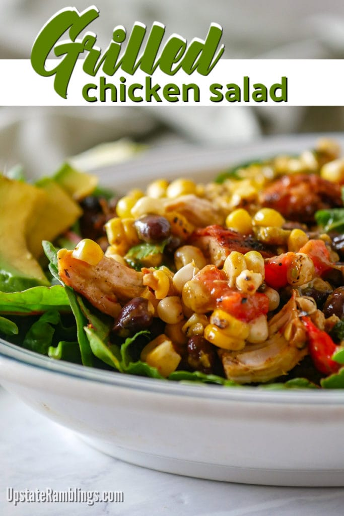 This Southwestern grilled chicken salad is a tasty mix of chicken, black beans, corn, red pepper and poblano pepper, topped off with a creamy Avocado-Lime dressing. It makes a tasty dinner or a great dish for a summer barbecue. Serve on lettuce, with tortilla chips or in a wrap. #chickensalad #grilledchickensalad #southwestern