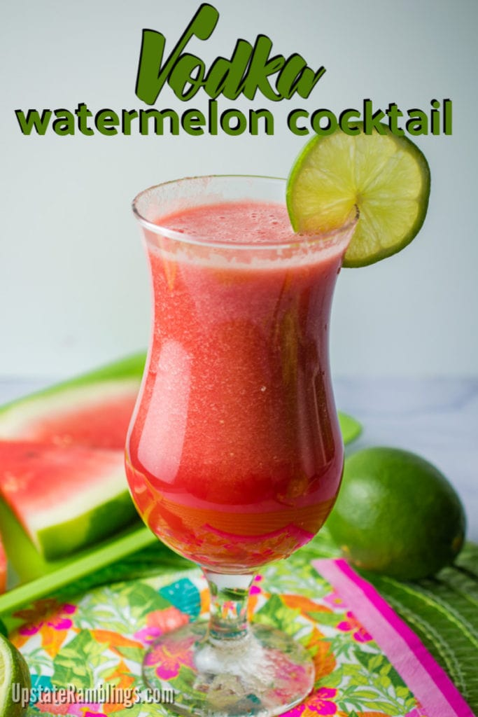 Vodka watemelon cocktail in a glass garnished with fresh lime