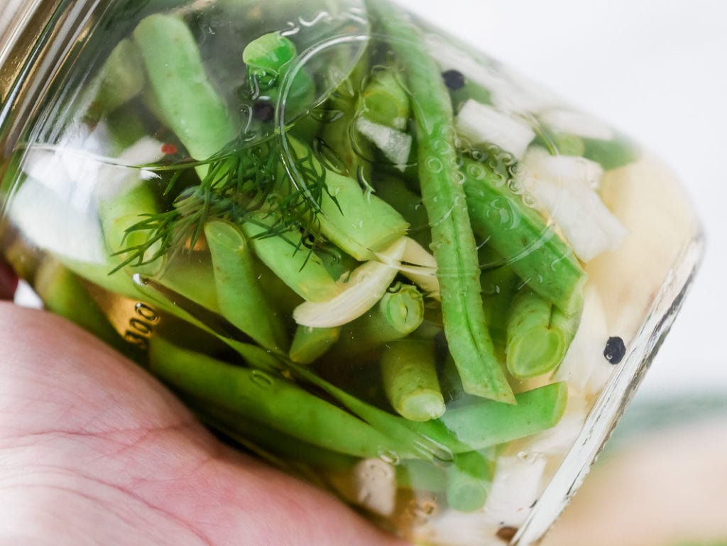 close up of quick pickled green beans in a jar