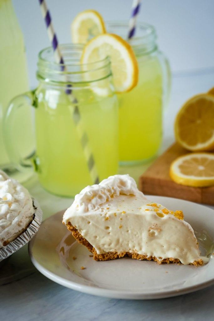 frozen lemonade pie in front of a pitcher of lemonade