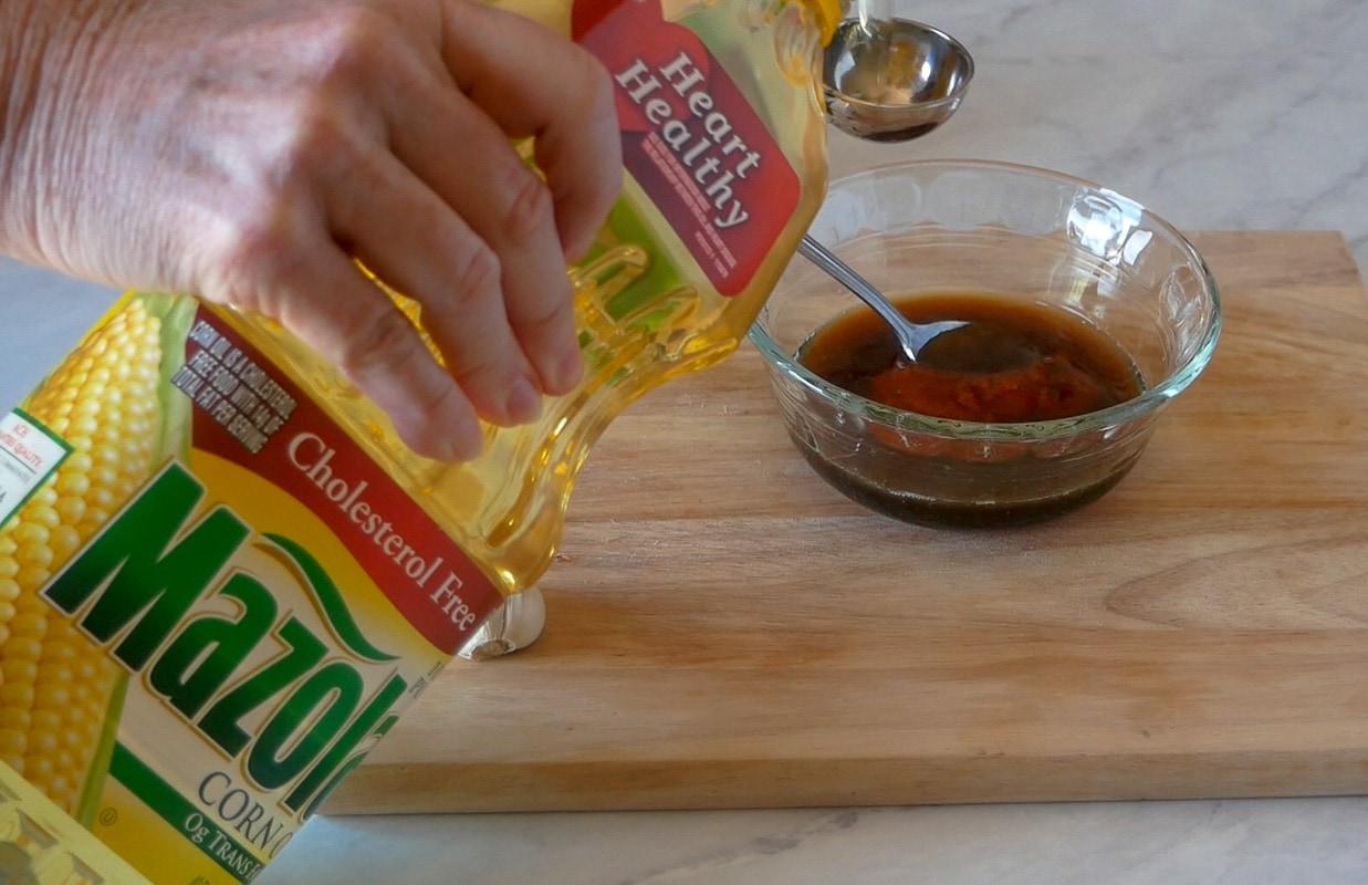 adding mazola to the salmon marinade