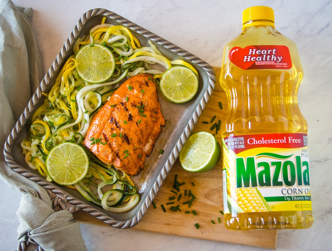 grilled salmon next to a bottle of mazola