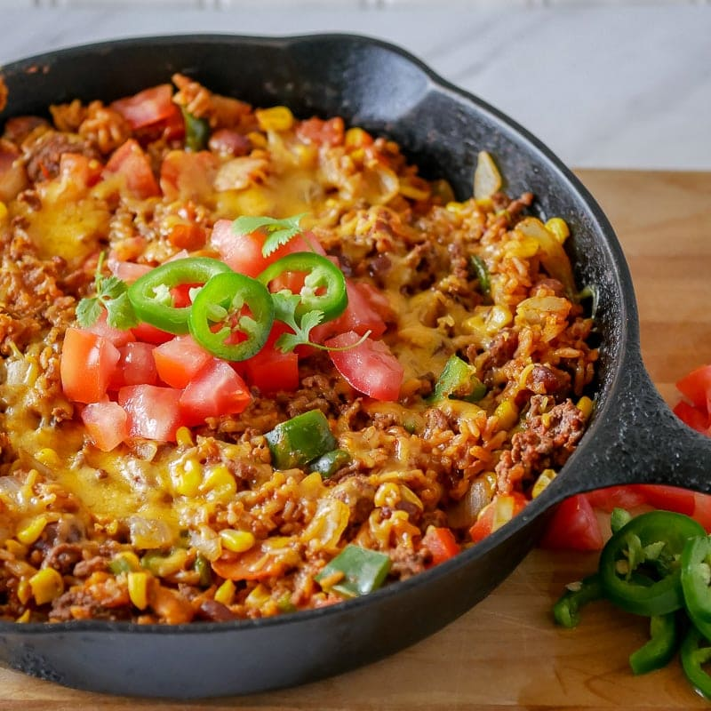 taco skillet dinner - beef, tomatoes, cheese, rice and beans