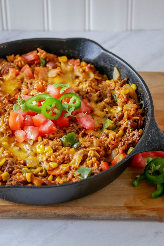 cast iron skillet dinner - beef with taco seasonings and rice topped with cheese
