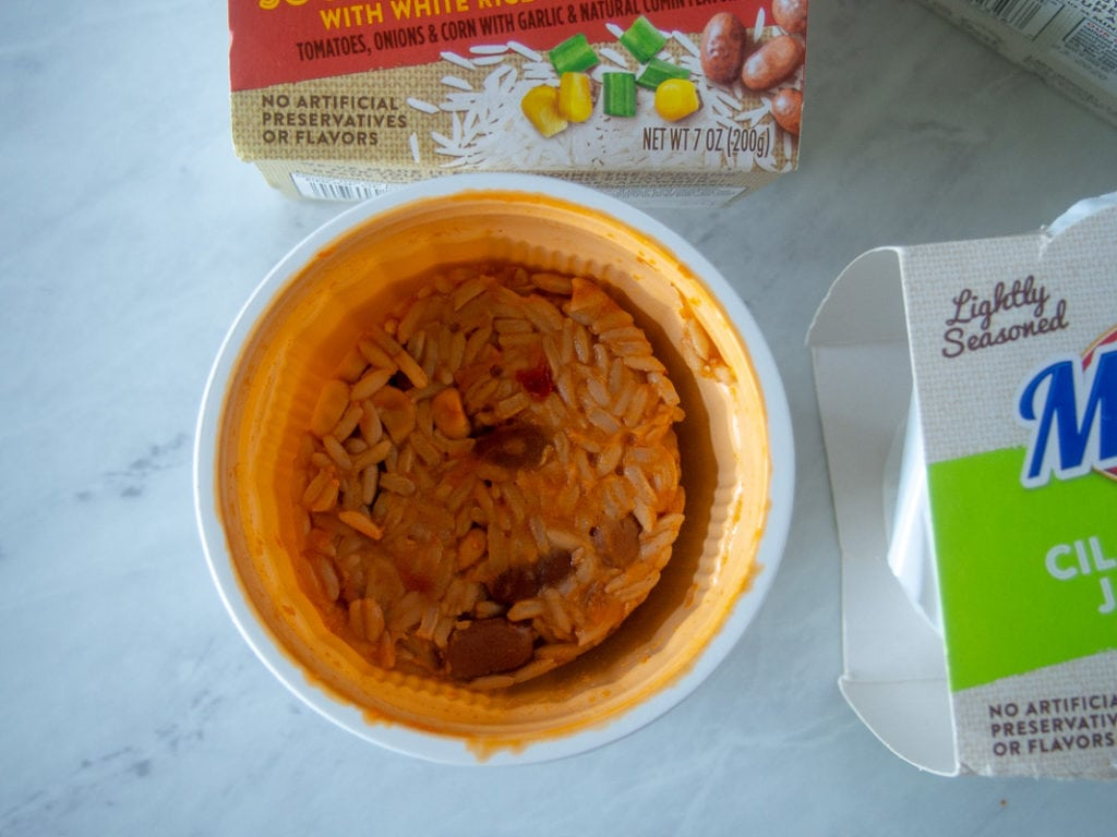 Container of minute rice with pinto beans