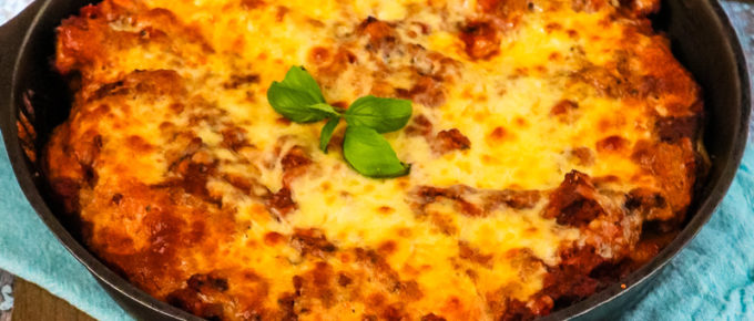 easy stuffed baked manicotti in a cast iron skillet